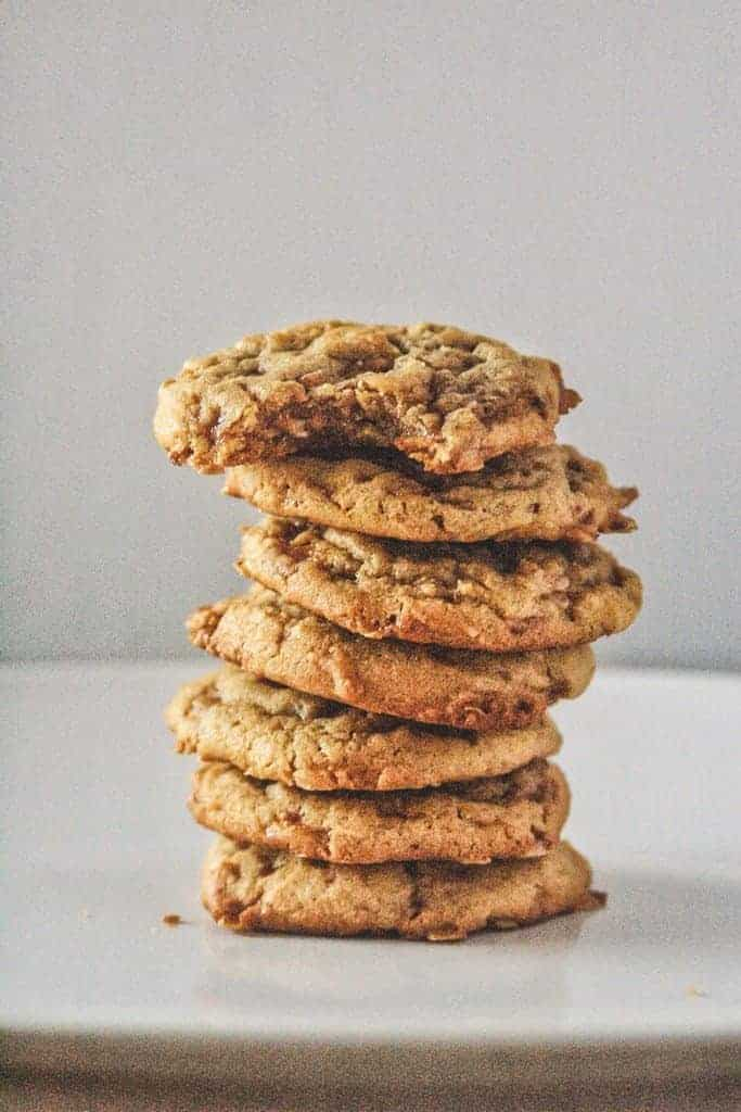A stack of seven cookies on a white plate