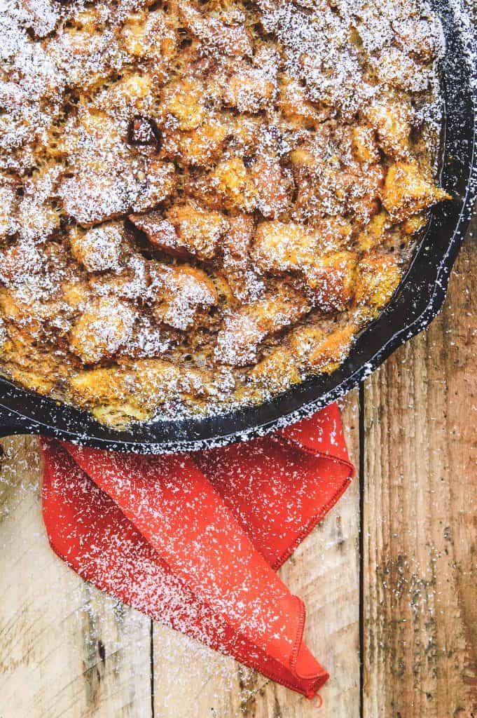 pumpkin pecan french toast in a skillet with a red napkin