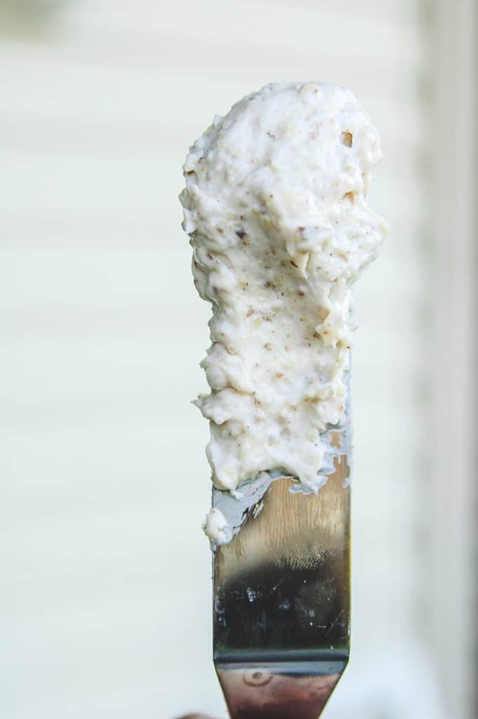 metal spatula with honey pecan cream cheese on the blade