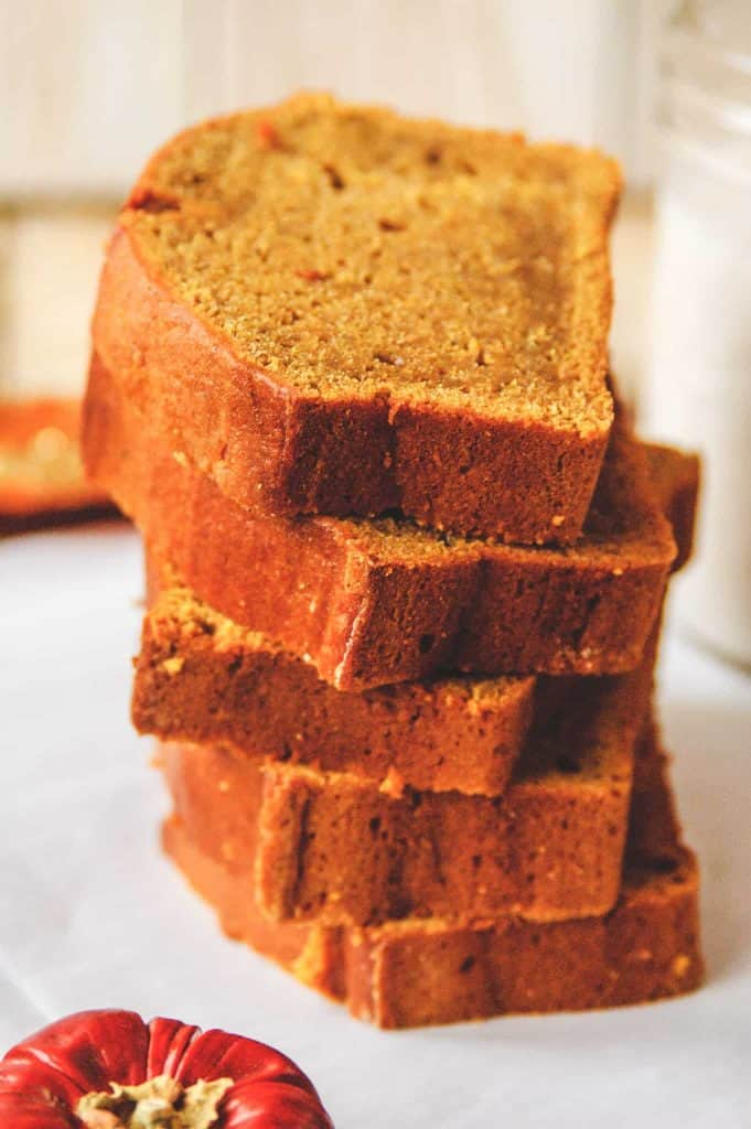 A stack of 5 thick slices of pumpkin bread