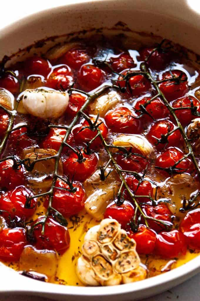 roasted cherry tomatoes with garlic and onion in oil