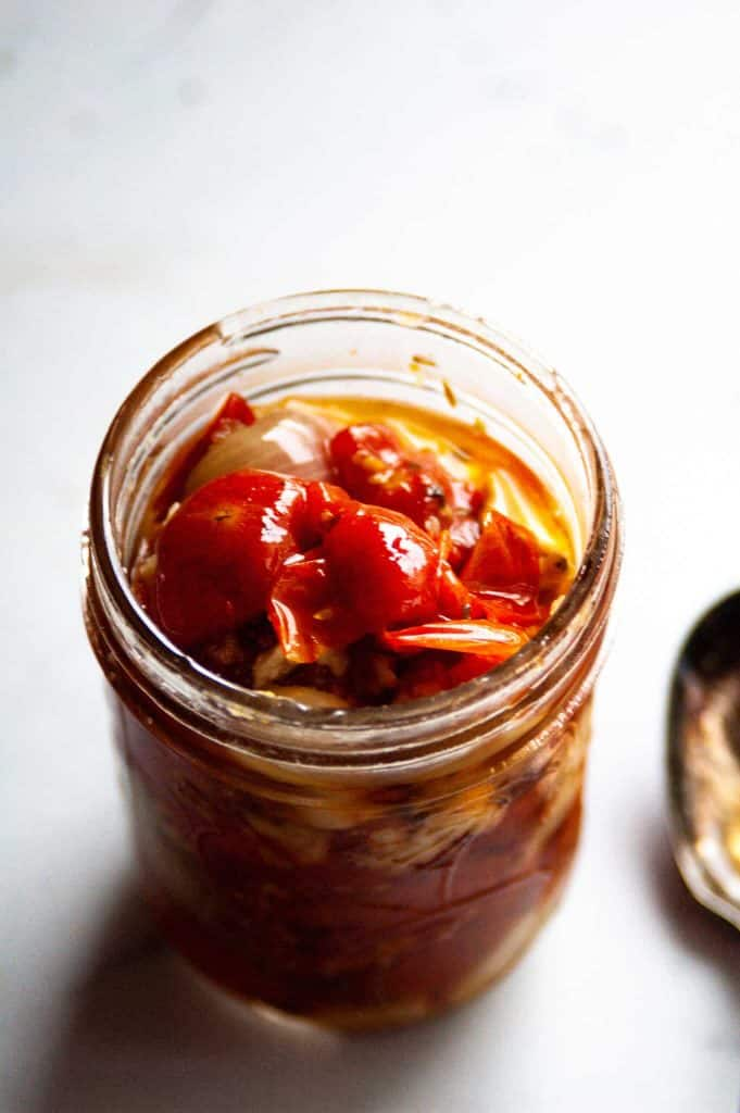 cherry tomato confit in a small glass jar